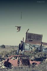 Sillas Voladoras .- 2008 (RolanGonzalez) Tags: field campo chatarra