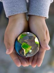 globe-hands-sm by noticelj