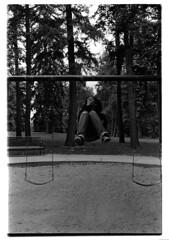 Swingin' and Smokin' (NegesoMuso) Tags: blackandwhite bw slr film playground 35mm scans minolta heather denver smoking analogue swinging fullframe conceptual dyi cheesmanpark youngatheart printedbyme ucdintrotophotofall2008
