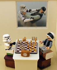 Some foes do become friends. (waihey) Tags: clock window table starwars fight play lego seat stormtroopers chess books strangle vanguard hasbro