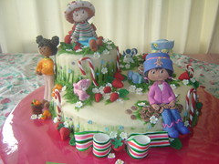strawberry shortcake (The Whole Cake and Caboodle ( lisa )) Tags: flowers newzealand cookies cake strawberry dolls strawberries custard oranges figures strawberryshortcake whangarei ssc candycanes gingersnap fondant shortcake buttercream orangeblossom caboodle angelcake pupcake berryland fondantaccents wmacoctober08 thewholecakeandcaboodle