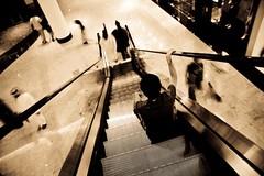 Home Sick (MitchGhost) Tags: city motion home canon mall bahrain escalator center filipino miss sick manama ofw 400d