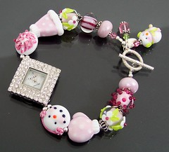 Estancia Designs Winter Wonderland Lampwork Watch (estanciadesigns) Tags: snowflake pink snow flower glass floral girl face hat beads handmade watch jewelry charm polka estancia designs handcrafted clasp wristwatch bling etsy dots earmuffs rhinestone couture lampwork mitten toggle trendz blingy