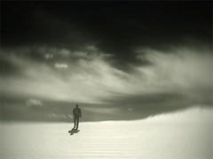 contemplative journey (soleá) Tags: light sky bw man holland clouds dark walking sand dunes mysterious carmen solea 100faves fivestarsgallery mywinners platinumphoto aplusphoto flightsoffancyforever flickrsfinest100faves