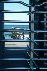 a view of the sea from behind the turnstile