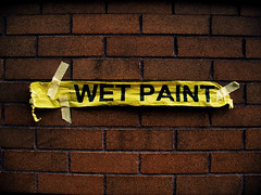WET PAINT (margolove) Tags: city brick sign wall oregon portland words downtown bright joke letters tape wetpaint agh