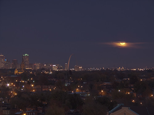 View from the top of the old South Side National Bank Tower, in Saint Louis, Missouri, USA - view of downtown at dusk with moonrise