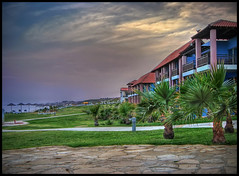 Aldiana Hotel, Mazotos, Cyprus (Mike G. K.) Tags: light sea sky beach clouds hotel stones cyprus palmtrees umbrellas hdr seaview alaminos appartments blaconies photomatix aldiana 3exp mywinners mazotos hdraddicted hdrvillage