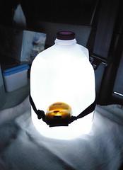 Reading lamp that is easy on the eyes... 20061004_6551 (listorama) Tags: camping light lamp car night diy milk bottle homemade subaru jug headlamp doityourself ut2006oct