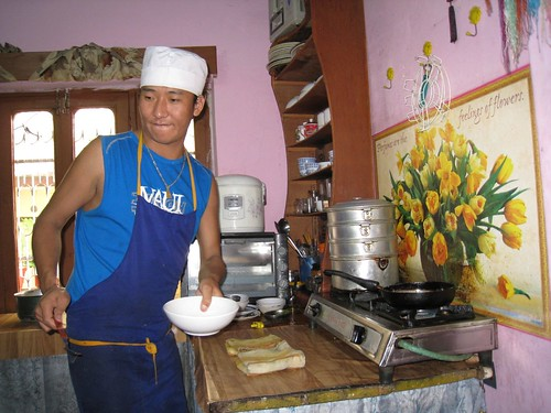 Lhamo at work in his kitchen