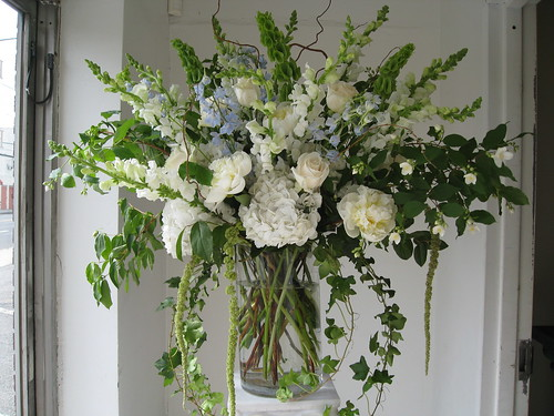 large ceremony arrangement, whites with a touch of blue Delphinium
