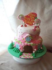 Strawberry Shortcake's house cake (Andrea's SweetCakes) Tags: birthday pink white house green cake cobblestone colourful lollipop strawberryshortcake