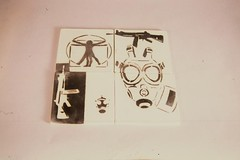 Hopelessly political Tiles (trepancrafts) Tags: stencils gasmasks ceramictiles