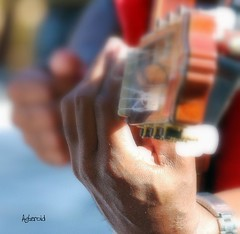 The hand that plays the guitar (Aster-oid) Tags: hands guitars greece rhodes faliraki ff33