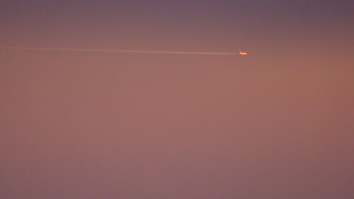 plane in red sky by fraktus.