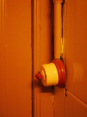 bathroom lightswitch, caelum, barcelona (martyn oliver) Tags: barcelona orange candlelight lightswitch candlelit caelum dmcfx5