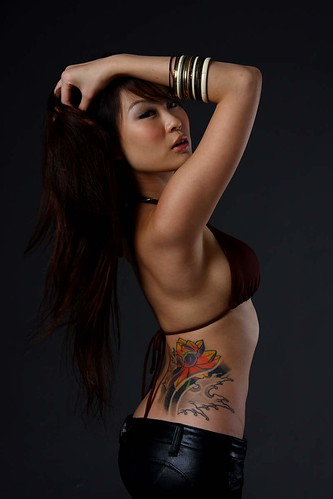 Sexy Wonen Flower Tattoo Design