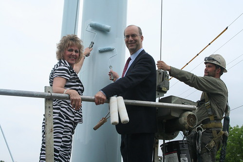 Anita J. (Janie) Dunning, Missouri State Director, and Jonathan Adelstein, RUS Administrator (center), painting the Ralls County PWSD No. 1 water tower