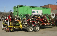 A truckload of dead gas lawnmowers, going to a Better Place.