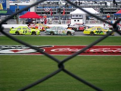through the fence (sun dazed) Tags: cars racetrack fence florida chainlink nascar daytona daytonainternationalspeedway pitroad