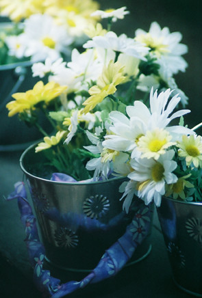 Pretty hand-picked flowers in buckets.