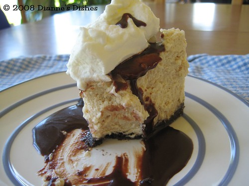 Peanut Butter Cheesecake with Hot Fudge Sauce and Whipped Cream