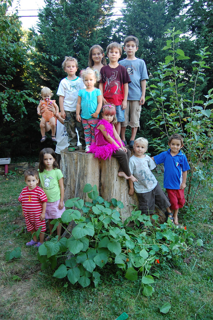 11 kids all looking at the camera