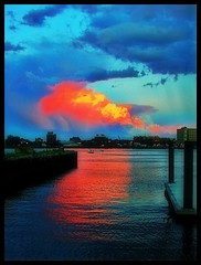 Boston harbor (Emily Taliaferro Prince) Tags: ocean blue light sunset red summer sky orange storm water boston clouds bay harbor boat massachusetts painter pointandshoot colourful stormclouds justclouds flickrsmasterpieces