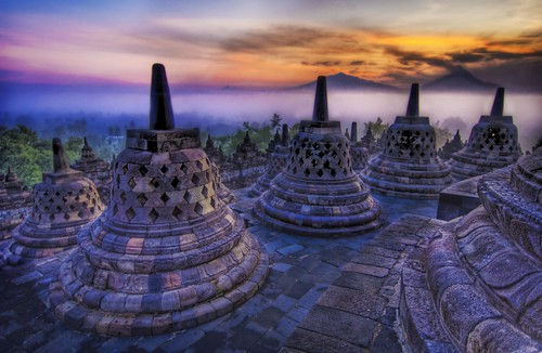 The sunrise as the caged Buddhas look on... / Trey Ratcliff