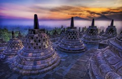 The sunrise as the caged Buddhas look on... (Stuck in Customs) Tags: travel panorama orange beautiful lines composition sunrise work indonesia photography nikon asia shoot peace asians photographer shot angle image photos unique buddha background stupa buddhist muslim details religion d2x perspective picture best adventure exotic caged edge processing mysterious pro meditation chorten framing top100 portfolio jogjakarta capture hindu 2008 indonesian hdr tutorial borobudur treatment chedi mostviewed reliquary tope highquality travelphotography garbha treysalbum hdrtutorial stuckincustoms treyratcliff burobudur chattrayashti dgaba