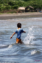 A Child at Play 2 (ibarra_svd) Tags: boy sea beach water canon asia southeastasia waves child play philippines filipino splash canondslr pinoy mindoro asianboy calapan asianchild filipinochild calapancity canoneos450d ormindoro southerntagalog mimaropa southeastasianboy philippinechild southeastasianchild philippineboy suquibeach