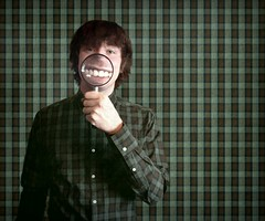 Wearing a big smile helps you to stand out (JenniPenni) Tags: boy green smile shirt pattern background teeth magnifyingglass 365 niko conceptual plaid