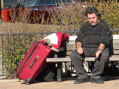 Traveling man (mmmmarshall) Tags: people bench sitting sit evanston suitcase seated hardtimes chicagoist