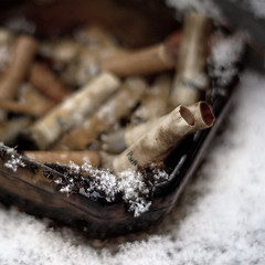 Freeze Your Butt Off (katherine lynn) Tags: winter snow snowflakes michigan smoking grandrapids cigarettes parliments bigmomma interestingness6 flickrchallengegroup flickrchallengewinner