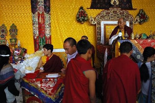 Blessing line, Lama HE Avikritar Rinpoche, his grandfather, HH Dagchen Sakya on the throne, Lamdre, Tharlam Monastery of Tibetan Buddhism, Amitayus Hayagriva Long Life empowerment, Tharlam Monastery stage, Boudha, Kathmandu, Nepal by Wonderlane