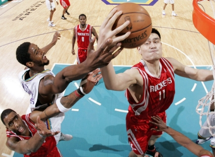 Yao Ming goes after one of his game-high 14 rebounds in a game where the Rockets made a statement by beating the Western Conference leading New Orleans Hornets.  Yao would also finish with 28 points on 12-of-21 shooting as the Rockets on their 11th game in a row.