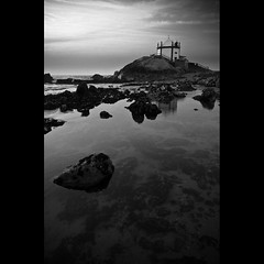 Over the ocean (trazmumbalde) Tags: ocean sea sky bw storm reflection beach portugal church water architecture landscape rocks europe meeting pb atlantic stunning gaia nikonstunninggallery pffg challengeyouwinner thebestwaterscapes