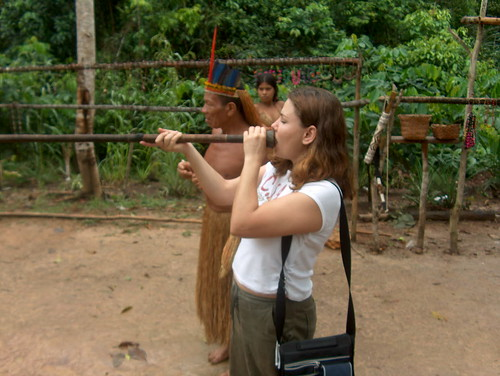 Lucy with the Yaguas tribal leader blowing a dart gun