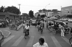 Old Meets New in Traffic (larryt135) Tags: china street blackandwhite bw car bicycle traffic candid beijing rushhour hutong tiananmensquare tiananmen streetphotgraphy