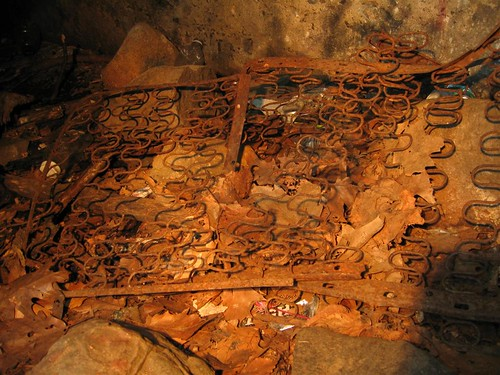 Rusted bed frame in the tunnel