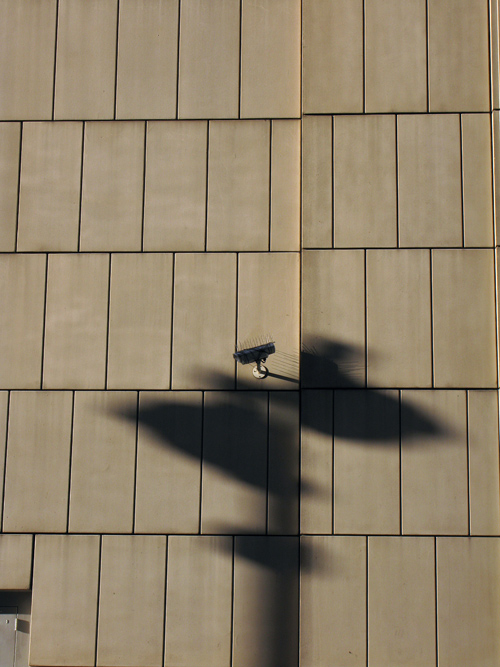 shadow of a securtiy camera on a Manhattan wall, NYC