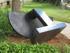 "Title: ""Abstract Folded Sculpture""Sculptor: Richard FieldAccessible to Public: yes, outdoorsLocation: Northfield Arts Guild TheaterOwnership: Medium: Steel, cor-ten steel enamelDimension: 37 inches high by 56 inches wide by 65 inches longProvenance:Year of Installation:Physical Condition: poor, needs base and maintenance"