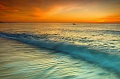 Sunrise for fishermen (cuellar) Tags: blue light orange seascape motion color colour luz lines azul marina sunrise landscape boat barca fishermen paisaje cuellar movimiento diagonal amanecer shape naranja almeria forma lineas pescadores mywinners vision1000 anawesomeshot impressedbeauty visiongroup goldstaraward vision100 cuellar2008top20