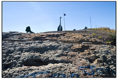 Dinosaur Invasion (swanksalot) Tags: sculpture southdakota dinosaur flag invasion rapidcity dinosaurpark sarahpalin swanksalot sethanderson tokina12mm24mm