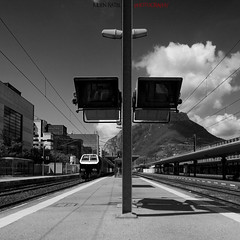 Departure for anywhere... (Julien Ratel ( Jll Jnsson )) Tags: railroad light bw cloud building station train grenoble canon square vanishingpoint gare perspective rail screen nb line tokina trainstation squareformat hugs nuage tar lampadaire ligne batiment cran goudron blueribbonwinner bisous flickrsbest 1224f4 40d mywinners platinumphoto infinestyle favemegroup5 theunforgettablepictures theperfectphotographer julienratel julienratelphotography carrfrancais