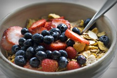 Tasty Breakfast (shallowend) Tags: breakfast cereal strawberries creativecommons d200 blueberries picnik shallowend afmicronikkor105mm