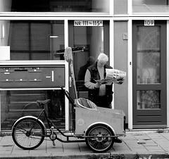 HE WANTS YESTERDAY'S PAPERS (Akbar Simonse) Tags: street people bw holland netherlands newspaper zwartwit candid thenetherlands streetphotography denhaag thehague streetshot zeeheldenkwartier 200000000stagelovers buurtbeheer akbarsimonse neighbourhoodcleansingandwastedisposaldepartment carriertrycycle