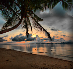 Sunrise in Koh Yao (!!love_and_lego!! - BUSY -) Tags: ocean trip sea panorama mer seascape water sunrise landscape thailand xt dawn seaside bravo asia meer mare alba palm journey getty thailandia eos350d fit italians phangnga amazingthailand kohyao koyao abigfave prestine aplusphoto holidaysvacanzeurlaub theunforgettablepictures massimilianogreco massimilianogreco travellingaroundthailand boatislandpoetry travellingaroundasia prestinewater fototrove