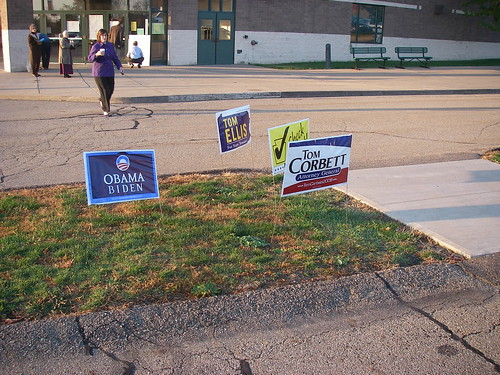 Some campaign signs outside the voting booth