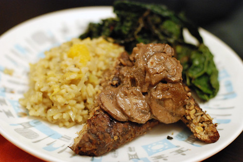 Grilled tempeh with rosemary-dijon-mushroom sauce, butternut squash and sage risotto, and balsamic-sauteed kale.
